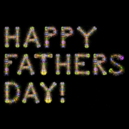 Happy Fathers Day written with Colorful Sparkling Fireworks over black sky  background Stock Photo