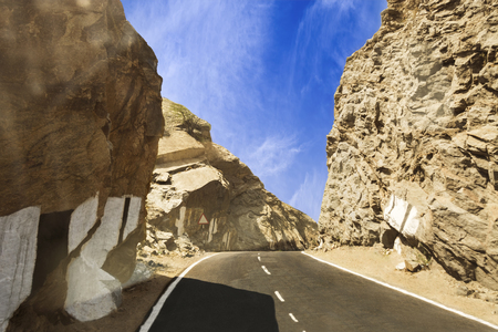 edges: Beautiful curving road through deserted cliffs and mountains between Ajmer and pushkar, Rajasthan, India