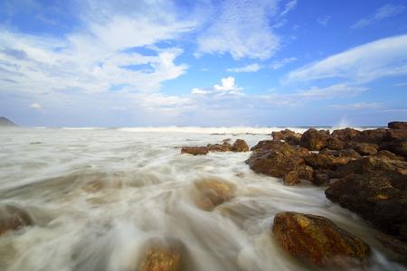 long nose: The beautiful silky smooth water waves and rocks at Yarada Beach, Visakhapatnam, India Stock Photo