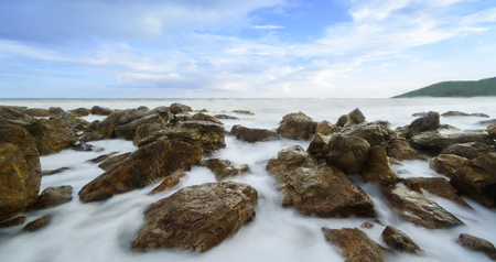 The beautiful silky smooth water waves and rocks at Yarada Beach, Visakhapatnam, India Stock Photo