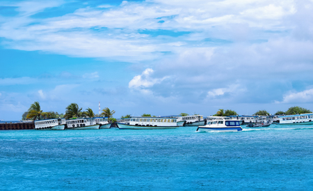 Panroamic view of boats moored at Male harbor, Maldive island on a sunny blue cloudy sky day holiday background