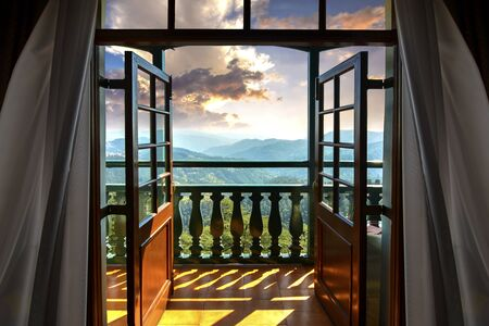 Light from the setting sun penetrating the clouds, falling on the balcony and entering the room as though calling the occupants to witness the mesmerizing view of Himalayan ranges in Shimla, looking like its gateway to Heaven