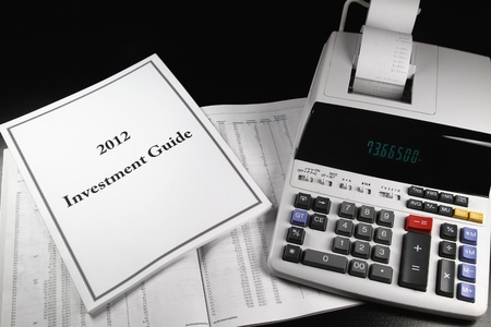 A 2012 investment guide on top of a prospectus.