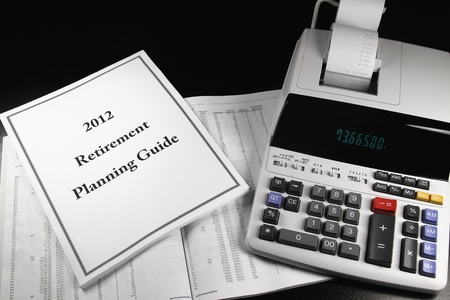 A 2012 retirement planning guide next to a calculator.