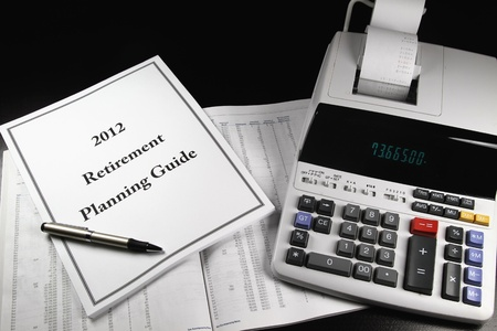 A 2012 retirement planning guide with a pen next to a calculator.