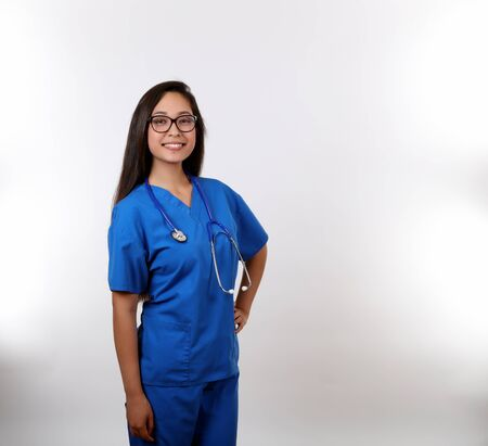 A latina nurse in blue uniform. 版權商用圖片