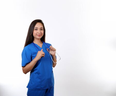A young hispanic nurse holding a stethoscope.
