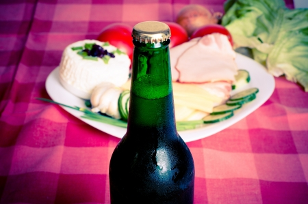 green bottle beer isolated on food background