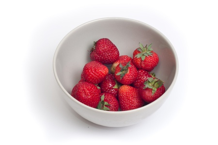 plate with strawberries on white background