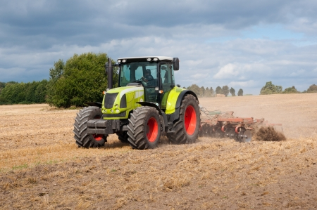 agricultural machinery: tractor on field