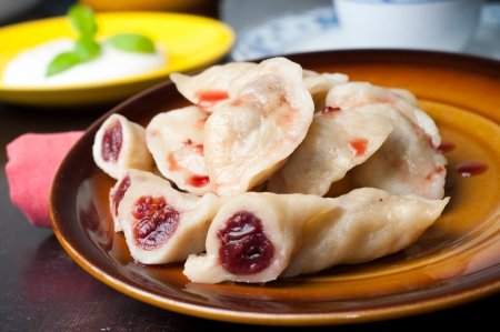 Traditional home handmade dumplings with morello cherries - country of origin Poland  Stock Photo