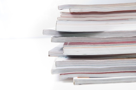 Stack of magazines on white
