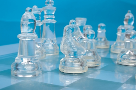 glass chess on the blue background photo