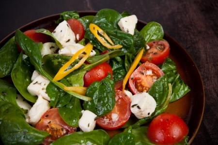 spinach lettuce with cheese mozarella and with tomatoes and spices Stock Photo