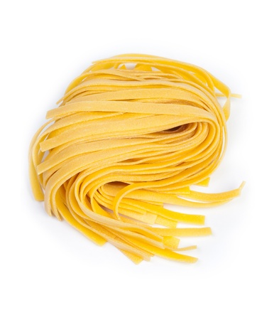 Yellow tagliatelle isolated on white