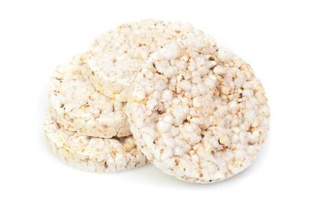 arroz blanco: aperitivo arroz inflado en el fondo blanco Foto de archivo