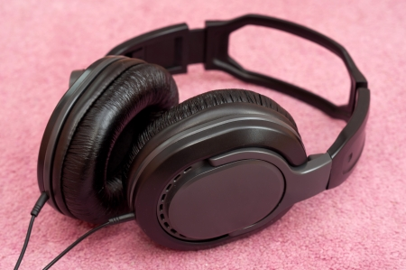 Stereo Headphones on colour background photo