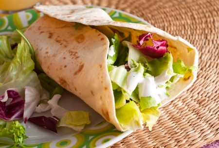 Chicken and vegetables wrapped in tortilla Stock Photo