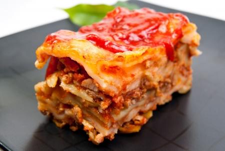 Portin of lasagne on dish Stock Photo