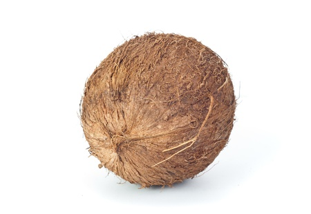 Fresh brown coconut isolated on white photo