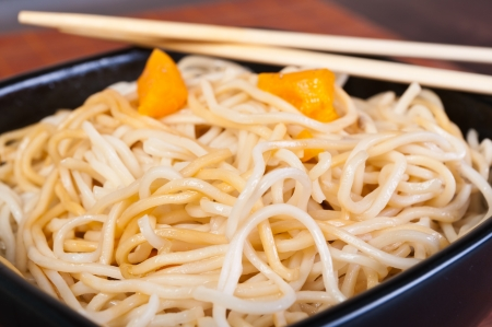 Chow mein noodles, asian dish - pasta in black plate photo