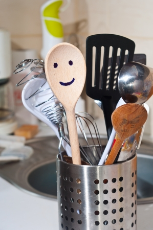 The wooden smiling spoon and kitchen accessories in the kitchen photo