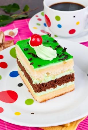 cream cake: cream cake with green glass on plate
