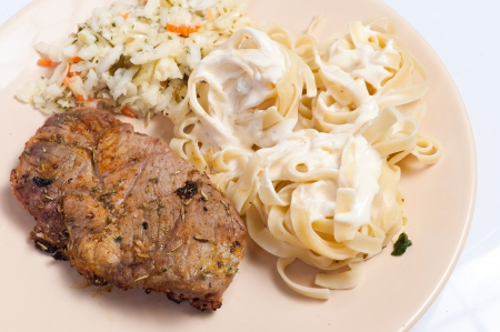 Home-made pork neck grilled with pasta