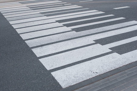 White keyboard piano painted pedestrian crossing on the road in Warsaw
