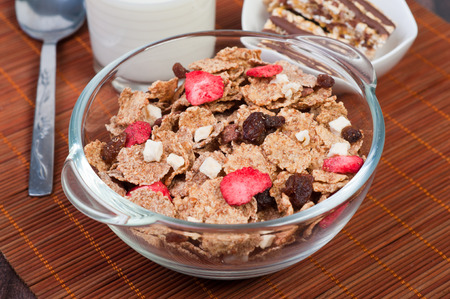 bar of chocolate muesli with petals poured with raisins with chocolate photo