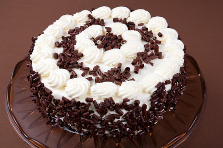 Creamy layer cake with chocolate shavings in the brown style
