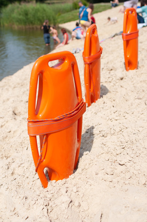 Lifeguard orange rescue equipment on beach in the summer