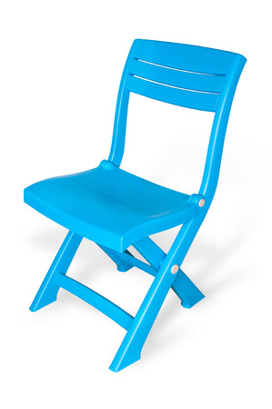 Blue plastic folding chair on white with clipping path. photo