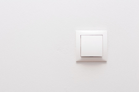 White light switch on a white wall