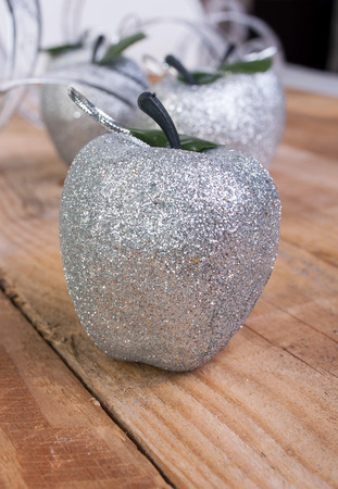 Christmas shiny silver metallic composition of apples