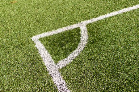 Line with corner of a football (soccer) on synthetic grass