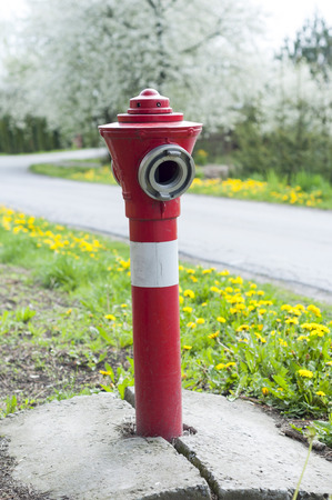 Red fire hydrant on the background of the road