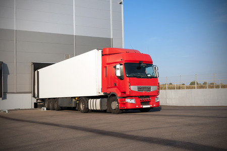 receives: The red truck receives delivery of warehouse logistics Stock Photo