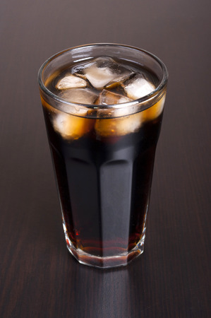 carbonation: Black cola in a glass with ice real, not plastic