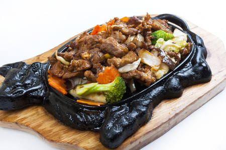 Beef on a hot plate in a Chinese style Stock Photo