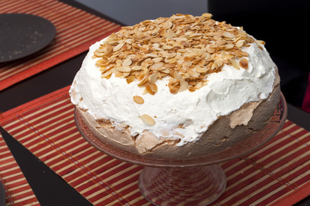 Meringue with whipped cream and pistachios Stock Photo