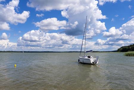 The boat on the lake Ros - Masuria (Mazury) Stock Photo