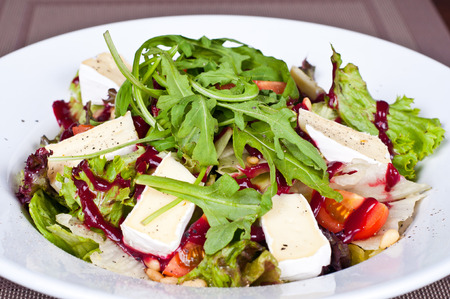 Salad of arugula with cheese and tomatoes Stock Photo