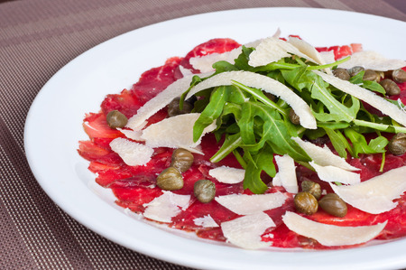 Italian ham with cheese, arugula and capers
