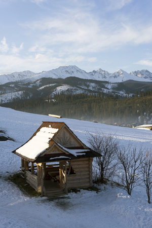 Winter mountains covered with snow, view from a big meadow in Tatry mountains in Poland