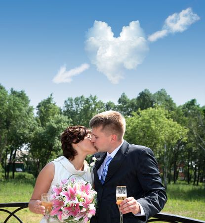 fiance: The girl and the young man kiss, and over them the cloud in the form of heart soars