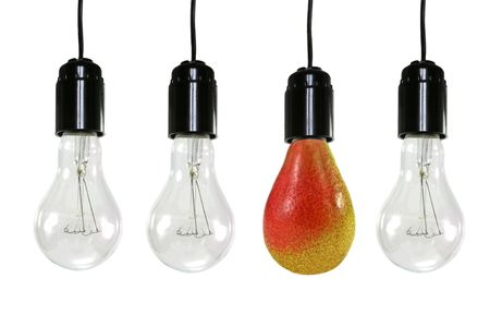 Three electric bulbs and one pear are isolated on a white background photo