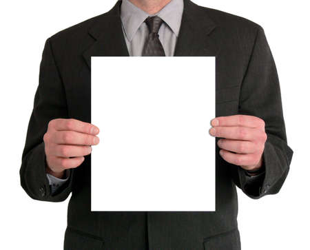 Image of a businessman's torso. He is holding a blank sheet of paper in front of him.  Stock Photo