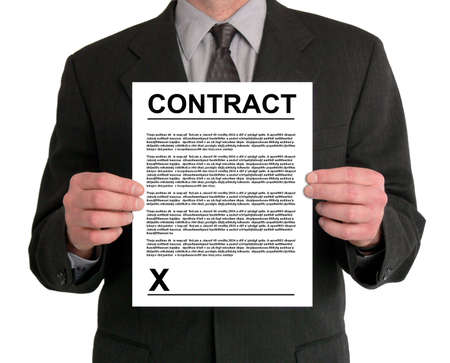 Image of a businessman's torso. He is holding a contract in front of him.