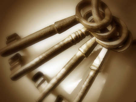 vignetted: Set of four oversized, cast iron antique keys on a ring. Entire image was given a brownsepia hue.